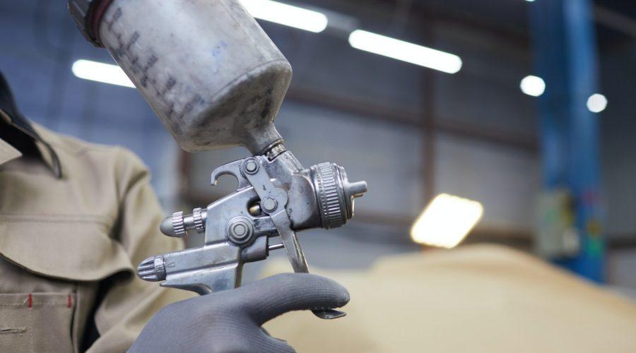 Spray-Gun With Paint In Hand